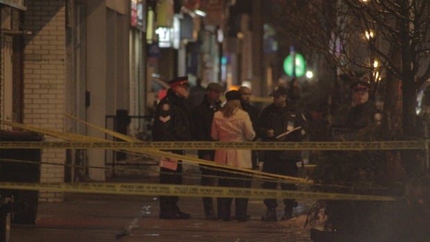 Police attend the scene after a double shooting near Danforth and Cedarvale.