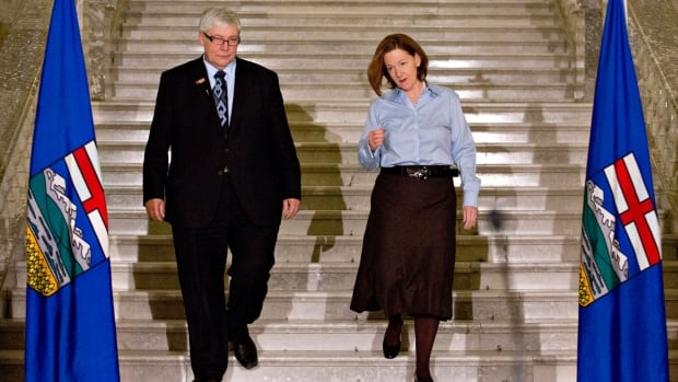 Deputy Premier Dave Hancock and Alberta Premier Alison Redford make their way to a press conference to announce Alison Redford's resignation in Edmonton.