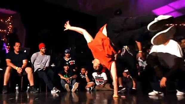 CBC reporter Matthew Kang doing a one arm freeze at a dance battle in Miami.