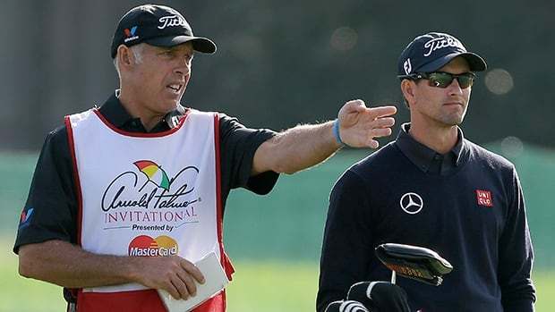 Caddie Steve Williams, left, gestures as he talks to Adam Scott on the 16th fairway during the first round of the Arnold Palmer Invitational golf tournament at Bay Hill on Thursday in Orlando, Fla.