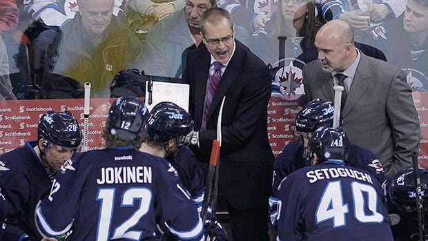 Winnipeg coach Paul Maurice, top centre, has helped guide the Jets back into contention for a playoff spot.