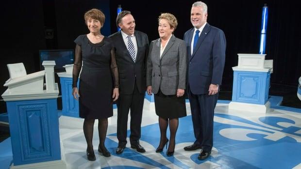 From left, Quebec Solidaire Leader Françoise David, Coalition Avenir Québec Leader François Legault, Parti Québécois leader Pauline Marois, and Liberal leader Philippe Couillard pose prior to the leaders' debate Thursday.