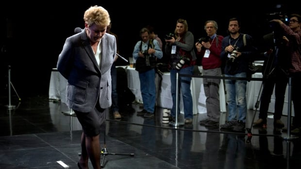 Parti Québécois Leader Pauline Marois leaves the stage after her post-debate news conference Thursday.