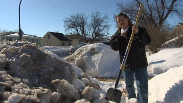 Marie Gabaravic, 63, is concerned emergency crews won't be able to get to her William Street home after a city plow pushed snow onto the sidewalk, making it impassable.