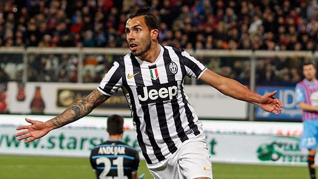 Carlos Tevez of Juventus celebrates after scoring against Catania at Stadio Angelo Massimino on March 23, 2014 in Catania, Italy.