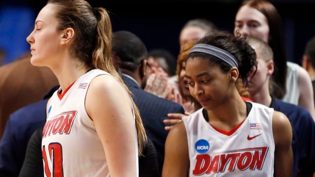 Dayton's Andrijana Cvitkovic (10) and Amber Deane (2) walks off the court after losing to Florida in a first-round game in the NCAA college basketball tournament on Sunday, March 23, 2014, in State College, Pa. Florida won 83-69. (AP Photo/)