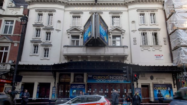 Police are seen outside London's Apollo Theatre on Dec. 20, 2013. Investigators have ruled that the partial ceiling collapse at the theatre was due to deterioration of cloth and plaster ties that have been in place since the venue opened in 1901.