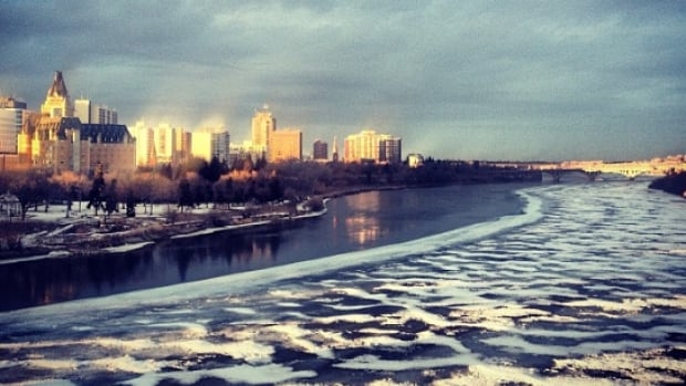 The view of downtown Saskatoon looking over the South Saskatchewan River from the Broadway Bridge.