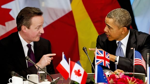 "British Prime Minister David Cameron, left, and U.S. President Barack Obama participate in a G7 leaders meeting during the Nuclear Security Summit in The Hague Monday. The G7 leaders declared support for Ukraine while condemning Russia's ""illegal"" annexation of Crimea and suspending participation in G8 meetings until Russia ""changes course."""