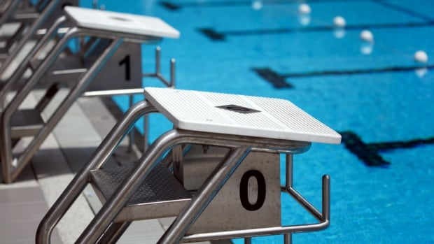 Stock image of starting blocks in a swimming pool.