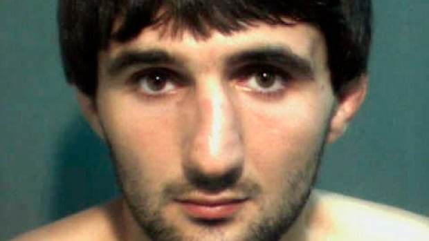 A police mug shot of Ibragim Todashev, an acquaintance of slain Boston Marathon bombing suspect Tamerlan Tsarnaev. Todashev was shot to death by an FBI agent while he was being interrogated about a 2011 triple homicide unrelated to the Boston bombing. A Florida prosecutor on Tuesday cleared the agent of criminal wrongdoing but questions about the shooting and the case underlying it remain.
