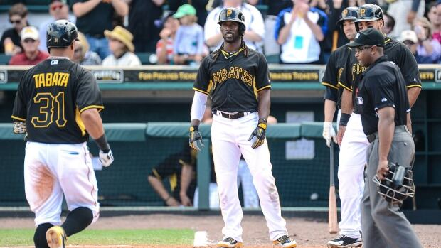 Pittsburgh Pirates centre fielder Andrew McCutchen, centre, watches teammate Jose Tabata, left, head for home plate after hitting a home run in the fourth inning of the spring training exhibition game against the Toronto Blue Jays at McKechnie Field on Tuesday.