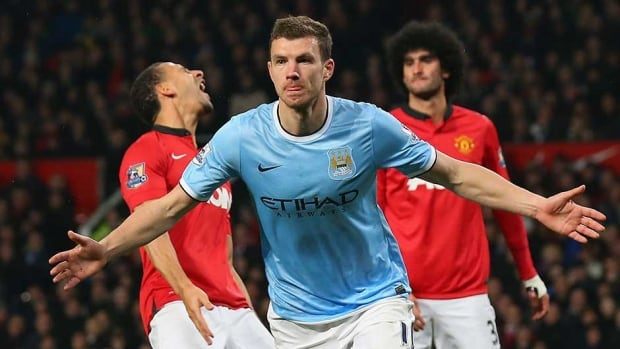 Edin Dzeko of Manchester City celebrates scoring the second goal during the Manchester United at Old Trafford on Tuesday in Manchester, England.