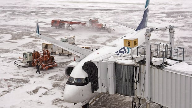Crews clear the runways at Halifax Stanfield International Airport after a January storm. There are already cancellations at the airport as the region prepares for another snowstorm.