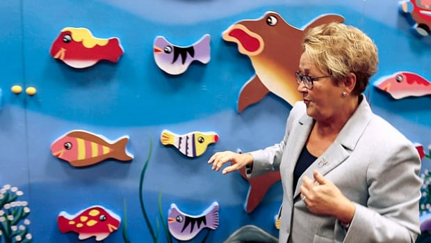 Fishing for votes? Or at least a campaign issue, Parti Quebecois Leader Pauline Marois tours a children's indoor play centre in Blainville on Tuesday.