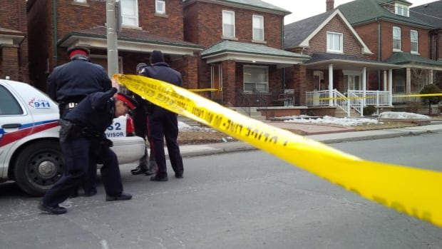 Police tape off an area on Symington Avenue, near Lansdowne and Davenport, after a man was shot and killed early Tuesday evening.