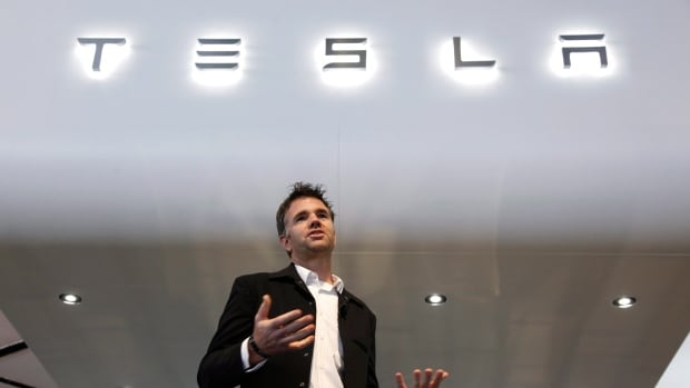 In this Tuesday, Jan. 15, 2013, file photo, Franz von Holzhausen, chief designer, Tesla Motors speaks at media previews for the North American International Auto Show in Detroit. Tesla has won a major victory in Ohio and will be allowed to keep its stores in the state open.