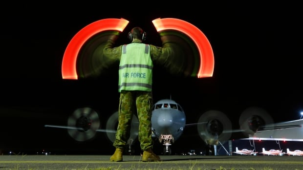A Royal Australian Air Force AP-3C Orion returns to RAAF Pearce airbase north of Perth after a fruitless search in the southern Indian Ocean for objects believed to be wreckage of Malaysian Airlines Flight MH370. The objects appeared in a fresh set of satellite images that authorities said were the best lead yet in the hunt for the plane that disappeared March 8.