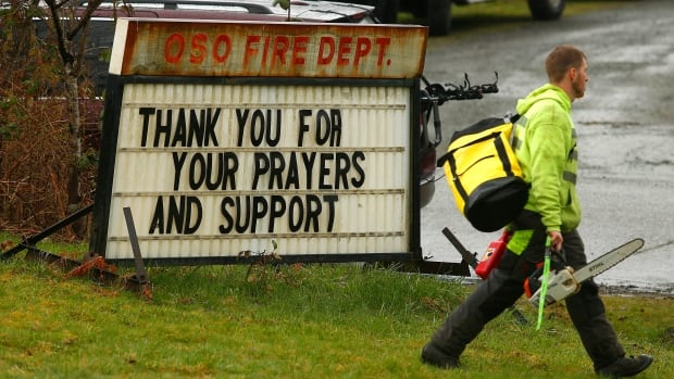 Volunteers arrive at the Oso Fire Department in Oso, Wash. Even after a disaster communities sometimes may give into what experts call 'hazard amnesia,' eventually forgetting about the need for diligence and preparedness as the incident recedes into the past.