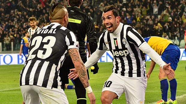 Juventus' Carlos Tevez, right, celebrates after scoring against Parma in Turin on March 26, 2014.