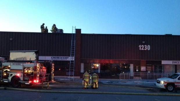 Fire crews were hampered by heavy smoke as they battled a blaze at an industrial building on Old Innes Road Thursday, March 27, 2014.