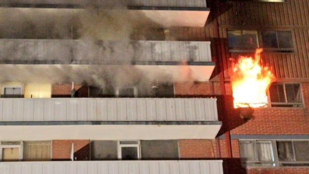 Fire crews arrived to find flames shooting out the window of this Dundas Street West apartment.