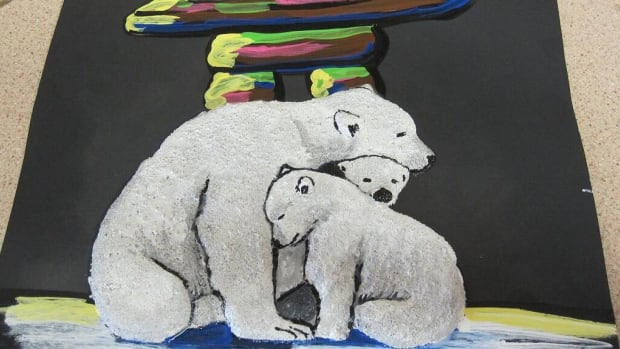 Lesia Anna's sand sculpture of a polar bear with twins, huddling against a storm, will be presented to Prince Charles during his visit to Winnipeg in May.