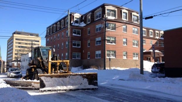 Saint John is considering a hiring freeze to cover the soaring snow-clearing budget.