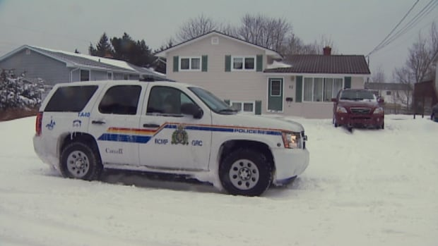 An RCMP vehicle outside of Reg Rankin's house on Wednesday.