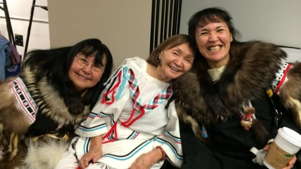 From left to right, Annie Aleequq, Minnie Freeman and Debbie Gordon-Ruben waiting to get into the Truth and Reconciliation Commission of Canada event in Edmonton.