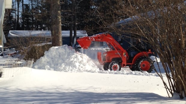 A driveway is cleared in Bridgewater following Wednesday's blizzard that dropped more than 40 centimetres of snow in some parts of the province.