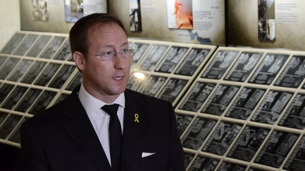 In July 2013, Defence Minister Peter MacKay unveils the travelling Afghanistan Memorial Vigil on Parliament Hill. The vigil contains the plaques originally displayed at the cenotaph in Afghanistan.