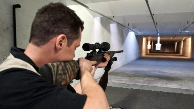 Patrick Deegan aims a long gun at a private range in Calgary in 2010. Deegan appeared in court today for threatening to kill hundreds of people at last year's Calgary Stampede.