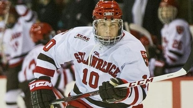 Former St. Lawrence University star Greg Carey, of Hamilton, has been signed as a free agent to the Phoenix Coyotes.