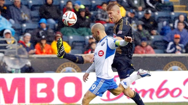Montreal Impact forward Marco Di Vaio (9) and Philadelphia Union forward Aaron Wheeler (12) compete for the ball during the second half Saturday.