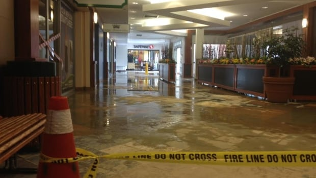 The interior of Brentwood Village Mall is flooded due to a water main break early this morning.