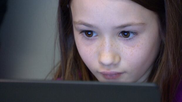 A young girl practices basic coding at the Girls Learning Code class hosted Saturday by Calgary's Chic Geek.