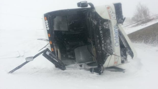 Two passengers were injured when a gust of wind knocked a bus off Highway 20 and sent it sliding down an embankment.