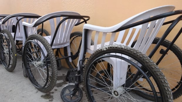 Short on most medical aids and devices, Haitians improvise and invent these wheelchairs using plastic lawn chairs and bicycle parts.