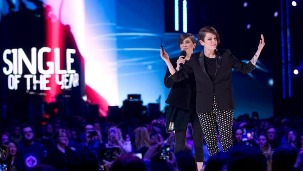 Tegan and Sara celebrate their Juno for single of the year during the Juno Awards in Winnipeg on SUnday. They appeared in a backstage skit with co-host Serena Ryder, punning up weather-related versions of their songs.