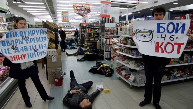 Participants stage a performance demanding that Ukrainians boycott Russian-made goods at a grocery store in Odessa after the annexation of Crimea by Russia.