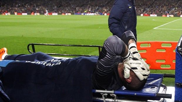 Victor Valdes of FC Barcelona lays injured on Wednesday in Barcelona, Spain. The goalkeeper underwent surgery to repair a torn ACL in his right knee and will miss the next seven months.