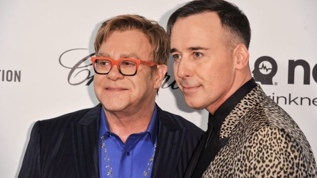 Elton John, left, and David Furnish arrive at the Elton John Oscar Viewing and After Party on March 2 in West Hollywood, Calif. The couple is planning to officially wed in May.
