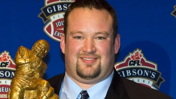 Scott Flory, seen here holding the CFL outstanding lineman trophy in 2008, is the CFL Players' Association's new president, succeeding Mike Morreale. He expects changes going forward with a new collective bargaining agreement.