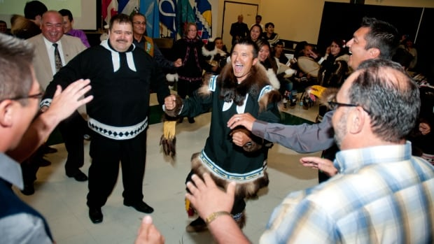 Politicians and local drummers celebrate at the signing of the devolution agreement in Inuvik, N.W.T., on June 25, 2013.