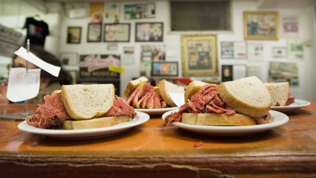 Smoked meat sandwiches sit on the counter at Schwartz's deli in Montreal, Thursday, March 8, 2012. Smoked meat lovers will have to fork over a little more cash the next time they visit the iconic Schwartz's deli in Montreal.