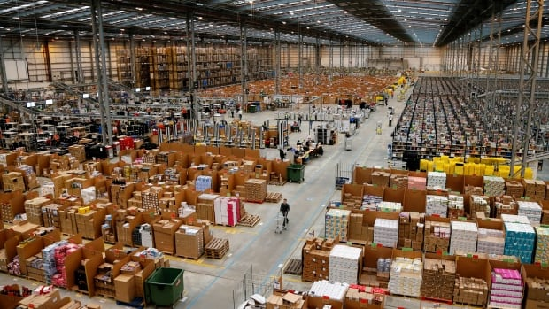An Amazon 'fulfilment centre' in England shows a vast supply of goods. On Tuesday, Amazon made more than a million new products available on its Canadian website as it moves even further away from its roots as an online bookseller.