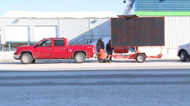 A sign reading 'Child molesters are not welcome' appeared outside the Inuvik courthouse this morning as Hugues Latour was entering. Latour has faced numerous charges in the past, including invitation to sexual touching, but the charges were later stayed.