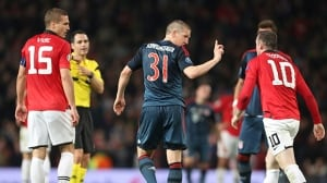 Bayern's Bastian Schweinsteiger, centre, argues with Manchester United's Wayne Rooney, after he was sent off the field during the Champions League quarter-final first leg at Old Trafford Stadium, Manchester, England, on Tuesday.