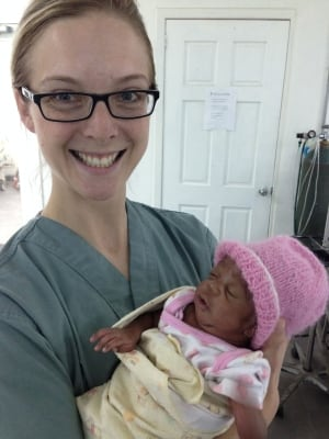 Natalie Bridger with abandoned baby in Haiti